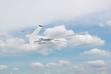 military RC military drone flies against the backdrop of blue peaceful sky with white clouds