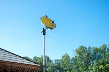 artificial satellite: Satellite dish made from pan in Luang Por Parn Khlong Dan Anu Sorn School,Samut Prakan Province in Thailand