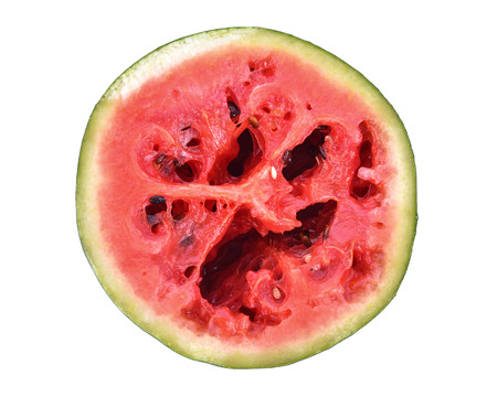 Red rot watermelon cut into pieces, placed on a white background.