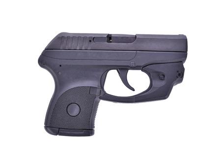 Small Handgun with laser guns on white background. Stock Photo