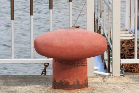 bollard: Red ship mooring bollard Stock Photo