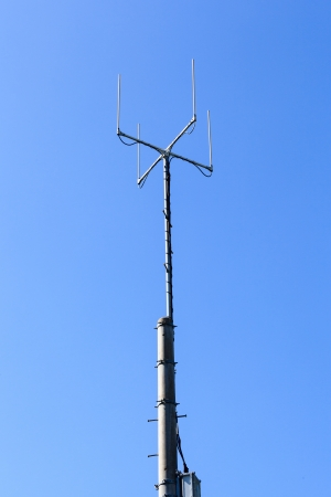 Telecoms tower with blue sky photo