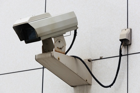 Outdoor Security Camera in a white wall photo