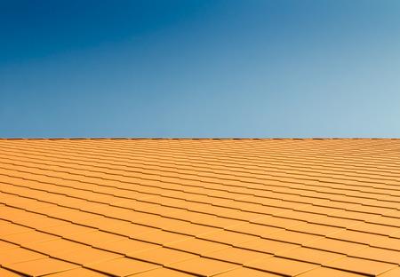 Orange roof against the sky photo