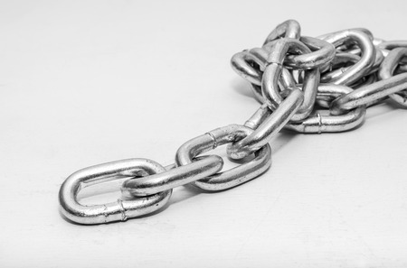 metal chain folded in a heap on white