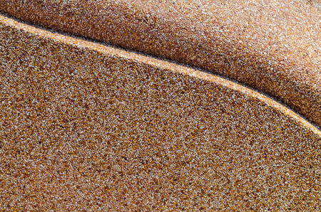 Wall surface gravel washed shades of brown pattern. photo