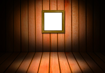 straggly: Picture gold frame and wooden interior room corner for background.