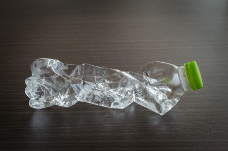 managing waste: plastic bottles that can be recycled on wood