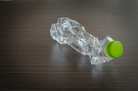 plastic bottles that can be recycled on wood photo