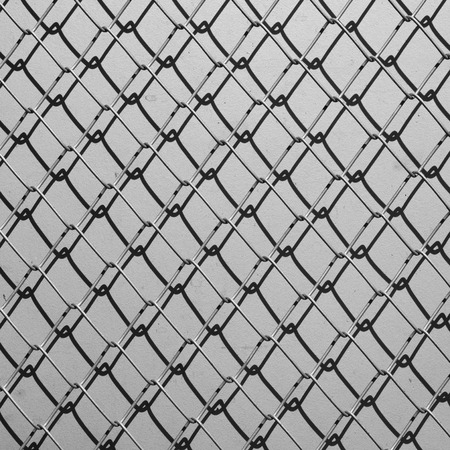 barbed wire frame: Obsolete gray grunge concrete closed with chain link fence and shadows