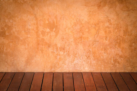 wooden floors: Brown plaster walls and wooden floors