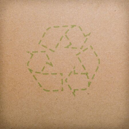 recycle logo on recycled paper background photo