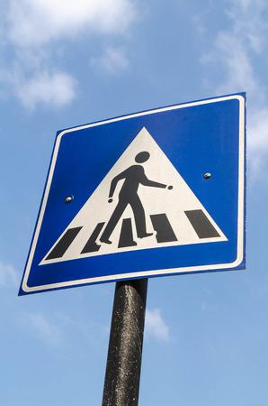 pedestrian: Pedestrian transit traffic sign over the sky