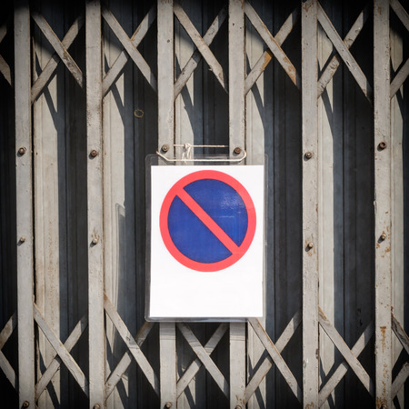architectural feature: weathered garage door with no parking sign Stock Photo