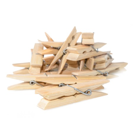 hang up: Close Up image of little office clothespins made from wood Stock Photo