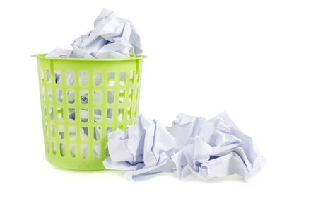 worthless: A trashcan full of crumpled paper Stock Photo