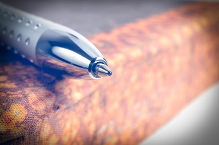classics: Pen on a old book. Macro image.
