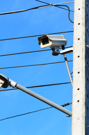 tangle: CCTV camera mounted on a pole and wiring tangle Stock Photo