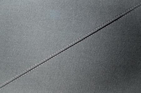 stitches: Kapron fabric with stitches of a white thread