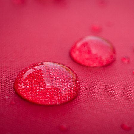 Water droplets on is fiber Waterproof fabric colorful Stock Photo