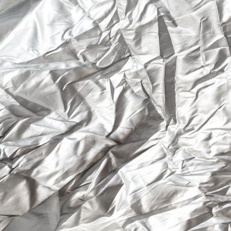 white cloth: Creased white cloth background