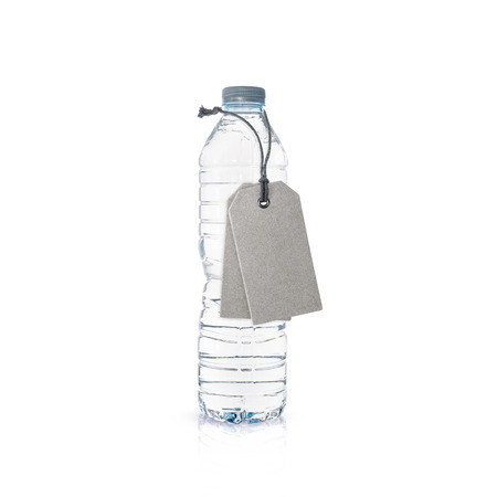 managing waste: Plastic bottle of drinking water and tags isolated on white