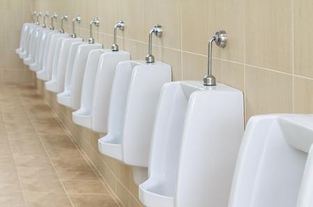 closeup white urinals in mens bathroom design of white ceramic urinals for men in toilet - Mens Bathroom