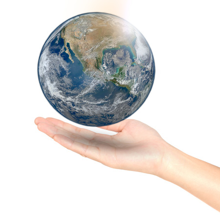 Earth at night was holding in woman hands