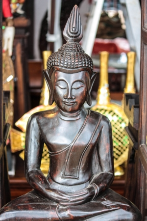 gold teakwood: the image of Buddha carves from gold teakwood Stock Photo