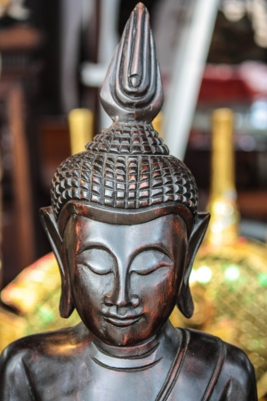 the image of Buddha carves from gold teakwood Stock Photo