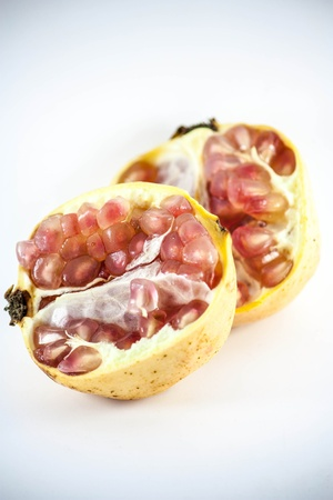 A group of pomegranates, one of them open to reveal the seeds  Stock Photo