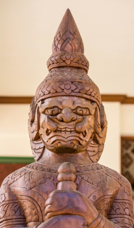 temple Thai demon makes of the teakwood photo