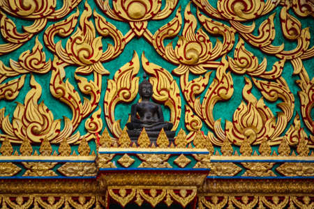 repetition: Detail of a traditionally painted window panel at Wat Poh Stock Photo
