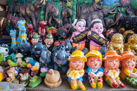 Many souvenir Russian wooden dolls, which are called Matryoshka and figures of temples Stock Photo - 18406308