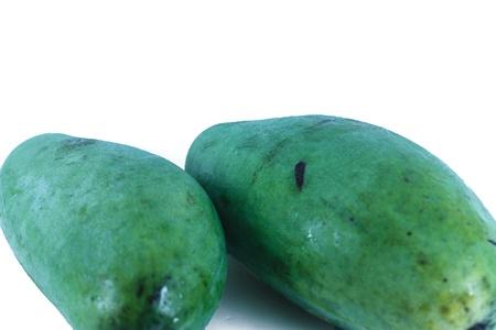 superfruit: unpeeled raw mango isolated on a white background Stock Photo