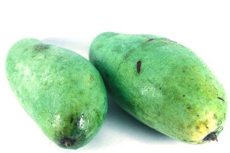 unpeeled: unpeeled raw mango isolated on a white background Stock Photo