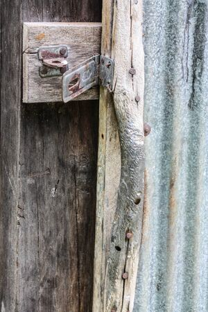 Old rusty iron door with master key lock photo