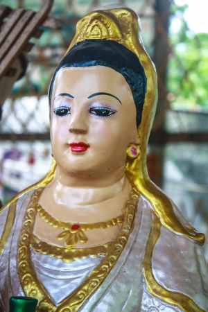 compassionate: Buddhist Goddess of Mercy and Compassion Stock Photo