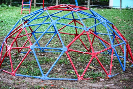jungle gym: Colorful Playground In A Park During Early Summer Stock Photo