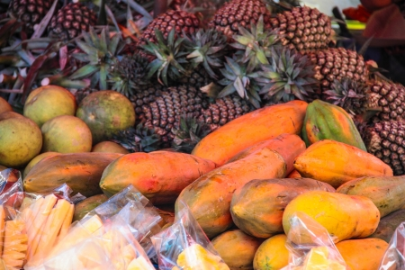 Colourful fruit and vegetable market stall in a rustic display photo