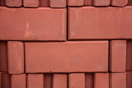 stack of red bricks, Shallow focus on front brick Stock Photo