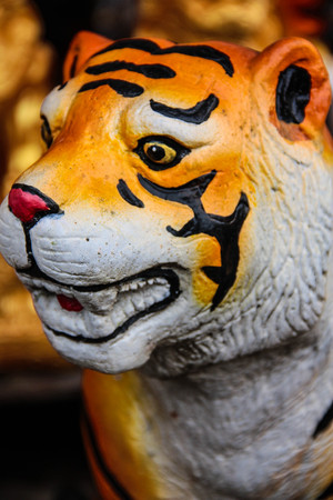 Fierce Orange Yellow Tiger Toy photo