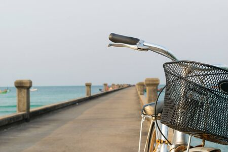 Bicycles parked on a bridge in the sea. Stock Photo