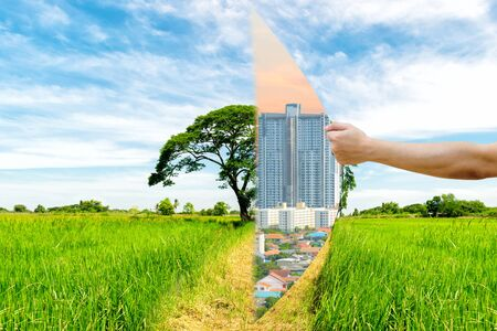 invade: Ecology Concept Hand pull Invade the forest a building Stock Photo