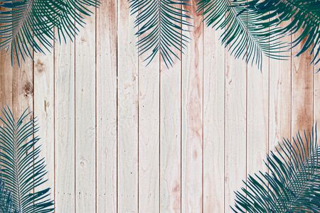 Vintage leaves on a wooden background Stock Photo