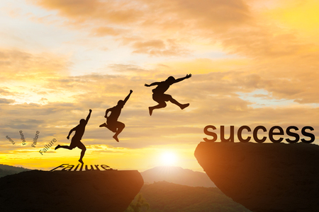 Men jump over silhouette failure committed to success.