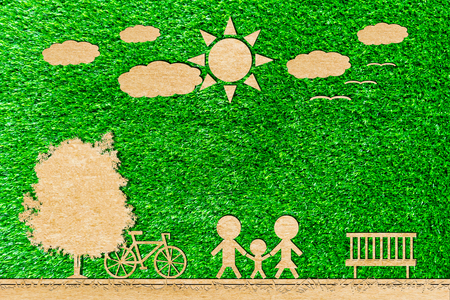 Family father mom and baby paper cut of bicycle sun tree cloud on a green background