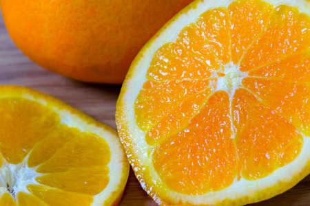 Oranges healthy fruit is placed on wooden floor.