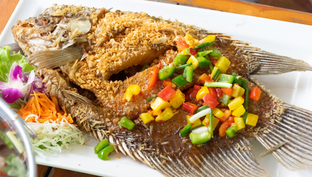 Fried fish garlic mango salad with mango and sweet and sour
