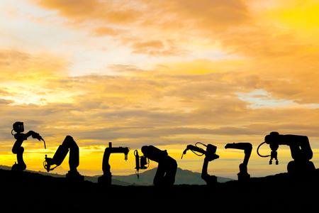 Industrial robot technology work future power of silhouette. 版權商用圖片